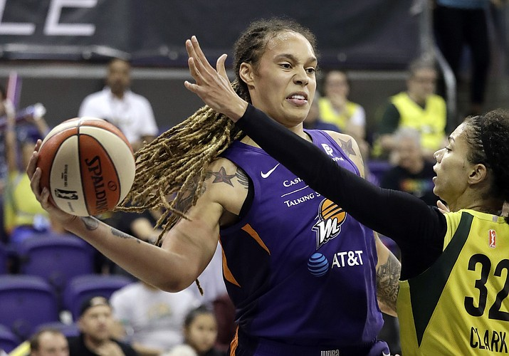 Phoenix Mercury's Brittney Griner, left, tries to get a pass past Seattle Storm's Alysha Clark (32) on June 30, 2019, in Seattle. Griner scored a season-high 31 points, including two free throws with 3.1 seconds left, to help the Phoenix Mercury beat the Atlanta Dream 65-63 on Sunday, July 7. (Elaine Thompson/AP, file)