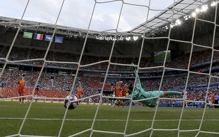 Netherlands goalkeeper Sari Van Veenendaal fails to shot by United States' Rose Lavelle who scored her side's second goal during the Women's World Cup final soccer match between US and The Netherlands at the Stade de Lyon in Decines, outside Lyon, France, Sunday, July 7, 2019. (AP Photo/David Vincent)