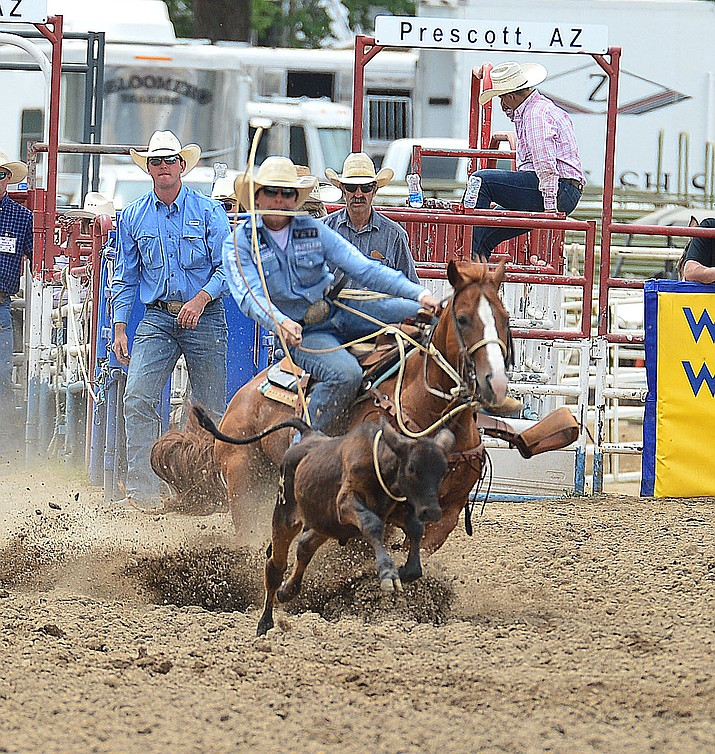 Tanner Green won the all-around title by winning money in the tie down roping and team roping during the final performance of the Prescott Frontier Days Rodeo on Sunday, July 7, 2019.  (Les Stukenberg/Courier)