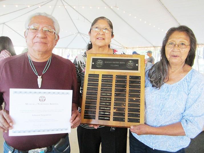 Tyson Nequatewa, Debbie Onsae and Verlie Lomastska accept the Distinguished Fellow award given to Edmund Nequatewa at MNA July 5. (Katherine Locke/NHO)