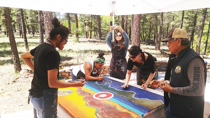 Bahe Whitethorne Sr. was the master teacher at the Namingha Institute held June 10-15 at the Museum of Northern Arizona. Above: Whitethrone surveys the artwork students are creating.  (Kevin Moriarty/NHO)