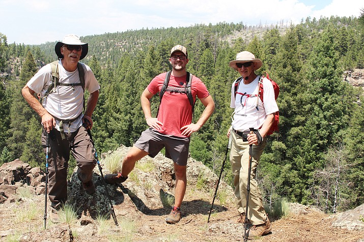 Rex Naumetz, Scott Johnson and Larry Byk overlook Walnut Canyon. (Stan Bindell/NHO)