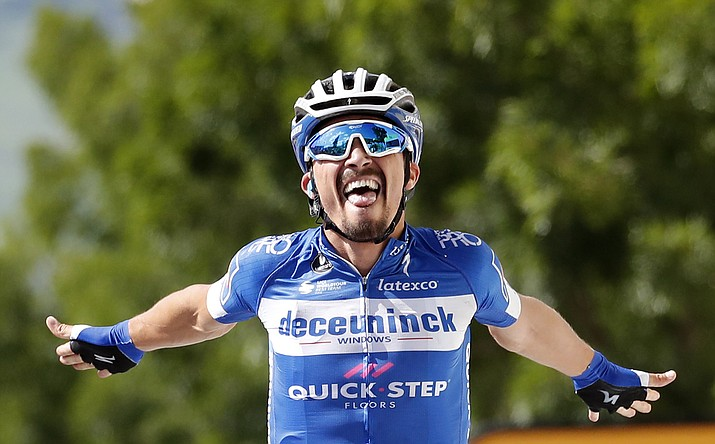 France's Julian Alaphilippe celebrates as he crosses the finish line to win the third stage of the Tour de France cycling race over 215 kilometers (133,6 miles) with start in Binche and finish in Epernay, Monday, July 8, 2019. (Christophe Ena/AP)