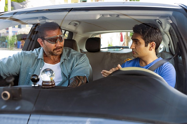 """This image released by 20th Century Fox shows Dave Bautista, left, and Kumail Nanjiani in a scene from """"Stuber."""" (Mark Hill/20th Century Fox via AP)"""