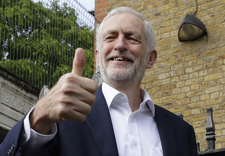 In this Thursday, May 23, 2019 file photo, Jeremy Corbyn leader of Britain's opposition Labour Party gives the thumbs up after voting in the European Elections in London. In a significant shift, Britain s main opposition Labour Party said Tuesday July 9, 2019, that Britain s next prime minister should hold a referendum on whether to leave the European Union or remain in the bloc. (Kirsty Wigglesworth/AP, File)