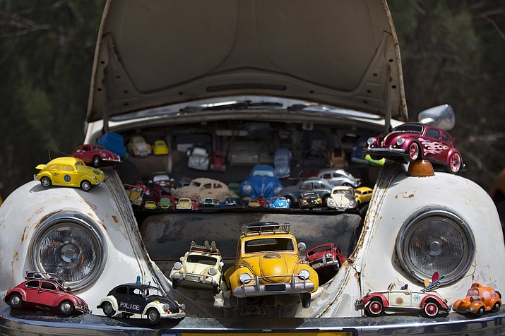 "In this April 21, 2017, file photo a collection of VW beetles car toys seen on Volkswagen Beetle displayed during the annual gathering of the ""Beetle Club"" in Yakum, central Israel. Volkswagen is halting production of the last version of its Beetle model in July 2019 at its plant in Puebla, Mexico, the end of the road for a vehicle that has symbolized many things over a history spanning eight decades since 1938. (Oded Balilty/AP)"
