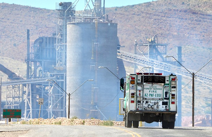 Police scanner reports at 3 p.m. Tuesday indicate the brush fire near the Clarkdale Phoenix Plant is under control with fire crews mopping up the last remnants of the blaze. VVN/Vyto Starinskas