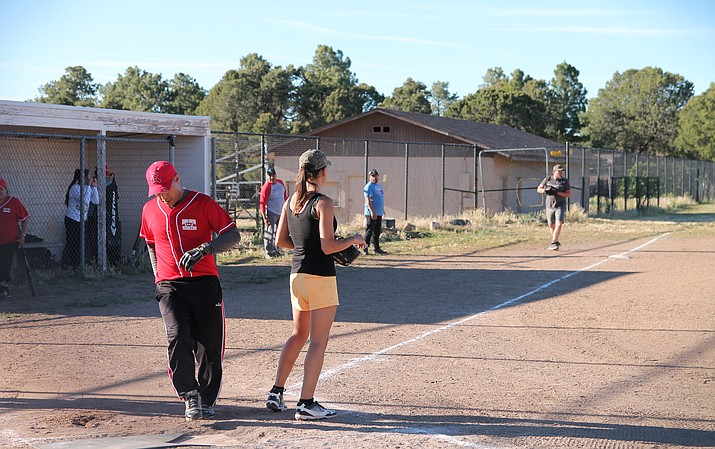 A runner crosses home plate during a Grand Canyon softball league game June 27. (Erin Ford/WGCN)
