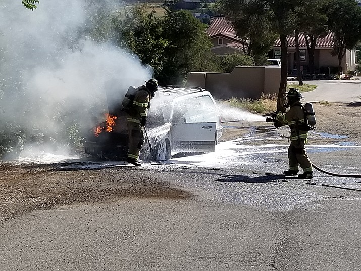 Prescott firefighters work on extinguishing a car fire that started in the 400 block of Frederick Lane in Prescott Tuesday morning, July 9.  (Prescott Fire Department/Courtesy)