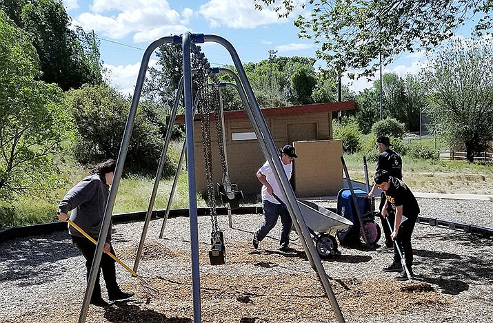 Youngsters from Yavapai County Juvenile Court's Community Restitution Program spread mulch at Pioneer Park in Prescott as part of their court-ordered community service work hours this summer. (Kaycee Grady/Courtesy)