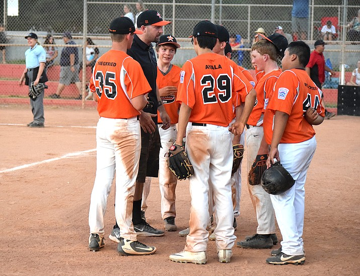 Williams Junior All-Stars meet with coach Kohl Nixon during a game with Verde Valley. (James Kelley/Verde Independent)