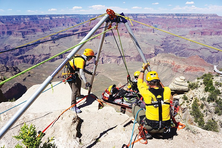 A simulated patient is raised up from the edge with a tripod utilized as the high directional during a week-long basic technical rescue training at Grand Canyon National Park. (Photo/NPS)