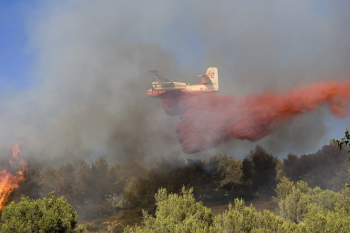 Fire retardant is dyed red to make the line visible when its dropped from air tankers like this DC-10. The mix of water and chemicals is used to delay combustion and slow the spread of flames. (stock photo)