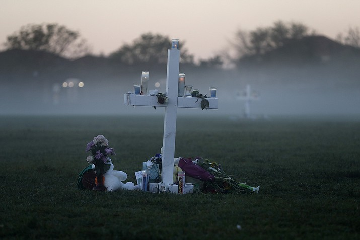 In this Feb. 17, 2018, file photo, an early morning fog rises where 17 memorial crosses were placed, for the 17 deceased students and faculty from the shooting at Marjory Stoneman Douglas High School in Parkland, Fla. One-third of the attackers who terrorized schools, houses of worship or businesses nationwide last year had a history of serious domestic violence, two-thirds had mental health issues, and nearly all had made threatening or concerning communications that worried others before they struck, according to a U.S. Secret Service report on mass attacks. (Gerald Herbert/AP, file)