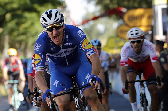 Italy's Elia Viviani celebrates as he crosses the finish line to win the fourth stage of the Tour de France cycling race over 214 kilometers (133 miles) with start in Reims and finish in Nancy, France, Tuesday, July 9, 2019. (Christophe Ena/AP)