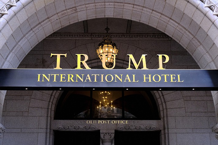 This March 11, 2019 file photo, shows the north entrance of the Trump International in Washington D.C. A federal appeals court has ordered the dismissal of a lawsuit accusing President Donald Trump of illegally profiting off the presidency. In a significant legal victory for Trump, a three-judge panel of the 4th U.S. Circuit Court of Appeals on Wednesday, July 10, 2019, overturned a ruling by a federal judge in Maryland who ruled last year that the lawsuit could move forward. (Mark Tenally/AP, File)