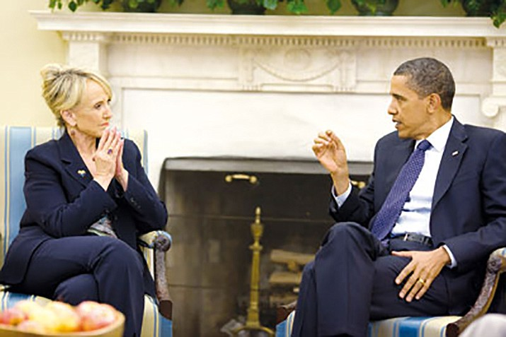 Former Arizona Governor Jan Brewer meets with President Barack Obama in June 2010 to discuss immigration and border security issues. A federal appeals court will be ruling on a core provision of Obama's signature health care law on whether it is unconstitutional. (File photo by Pete Souza/Official White House photo)