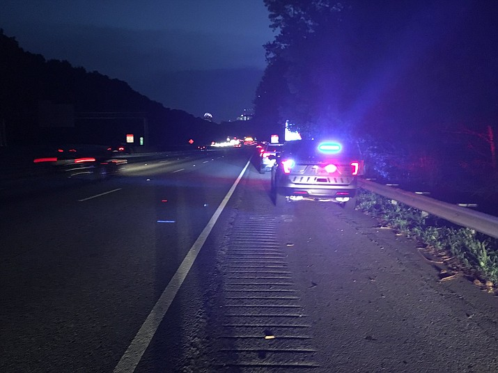 A rain of cash prompted a dozen or more drivers to pull over on I-285 near Ashford-Dunwoody Road. (Dunwoody Police Department)