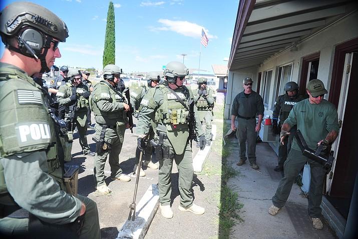 Prescott Valley Police use the former Prescott Valley Motel for training on breaching doors Wednesday July 10, 2019.  (Les Stukenberg/Courier)