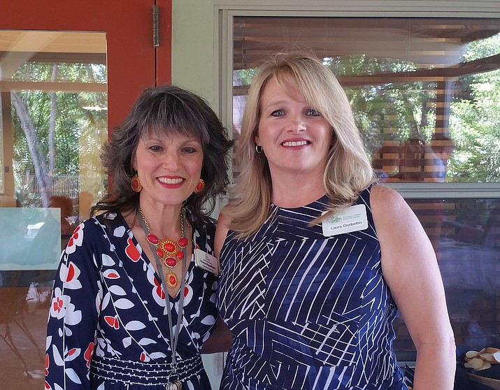 Yvonne Napolitano, left, executive director of the Margaret T. Morris Center, celebrates the facility's 20th anniversary with Laura Dreibelbis, program director for sister company Susan J. Rheem Adult Day Center. (Courtesy)
