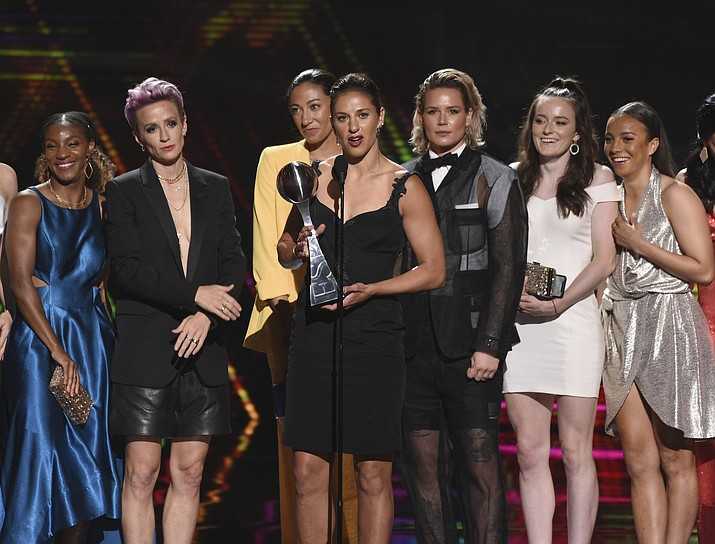 Carli Lloyd, center, and members of the U.S. women's national soccer team accept the award for best team at the ESPY Awards on Wednesday, July 10, 2019, at the Microsoft Theater in Los Angeles. (Photo by Chris Pizzello/Invision/AP)