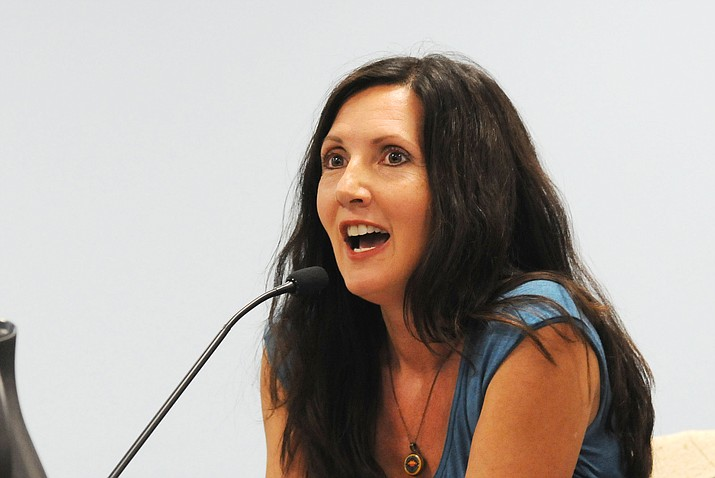 APS customer Stacey Champion tells state utility regulators on Wednesday they acted improperly in approving a rate hike for the company and urged them to roll back the charges. (Howard Fischer/ Capitol Media Services)