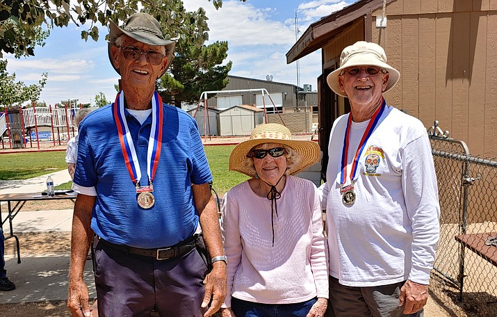Herb Baggett and Bob Dorfman stand with Sharon Germain after claiming first overall at the third annual Jerry Germain Memorial Horseshoe Tournament on June 29 in Prescott Valley. (Gary Taylor/Courtesy)