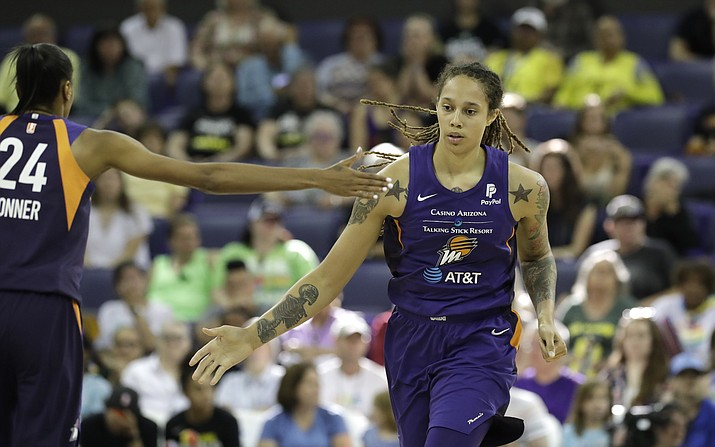 Phoenix Mercury's Brittney Griner, right, gets a high five from teammate DeWanna Bonner as they head to the sideline for a timeout against the Seattle Storm in the second half of a WNBA basketball game Sunday, June 30, 2019, in Seattle. The Mercury won 69-67. (Elaine Thompson/AP, file)