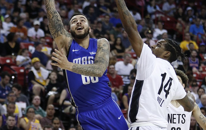 Orlando Magic's Gabe York, left, shoots around Brooklyn Nets' Ahmed Hill during the second half of an NBA summer league game Wednesday, July 10, 2019, in Las Vegas. (John Locher/AP)