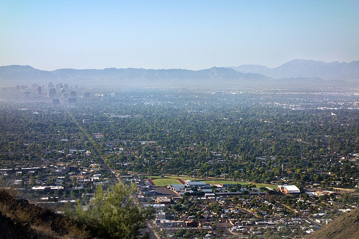 Pictured is air pollution from Interstate-10 and I-17 in the morning haze above the area of downtown Phoenix. Environmental regulators issued an ozone pollution advisory for metro Phoenix on Wednesday, July 10, 2019. The advisory was issued because the Phoenix area is expected to exceed the federal health standard for air quality on Wednesday. (Courier file photo)