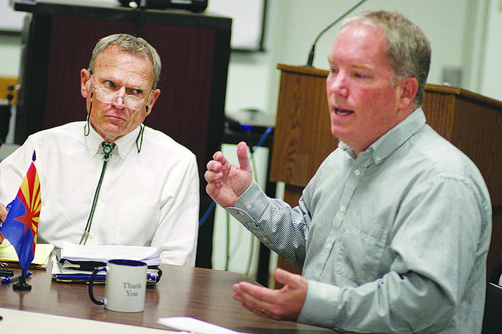 "Camp Verde Council Member Joe Butner, left, listens as Town Manager Russ Martin suggests the town seeks re-bids – that would include value engineering – on Phase 1B of the sports complex. Butner said that value engineering ""sounds like degrading the plan somewhat but getting pretty much what we set out to get."" VVN/Bill Helm"