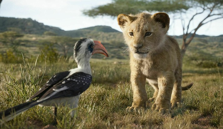 "This image released by Disney shows characters, from left, Zazu, voiced by John Oliver, and young Simba, voiced by JD McCrary, in a scene from ""The Lion King."" (Disney via AP)"