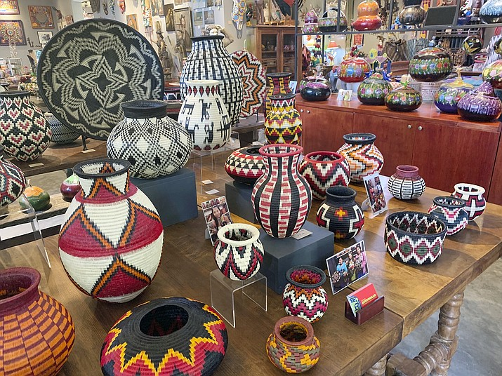 This photo shows a collection of Wounaan woven baskets from Colombia, at Galeria Atotonilco near San Miguel de Allende, Mexico. (Emil Varona/Kim Curtis via AP)