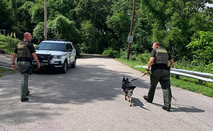Clay County Sheriff's Deputies and a K-9 search for a suspect with a felony arrest warrant. The suspect gave away their position with a loud fart. (Clay County, Missouri Sheriff)
