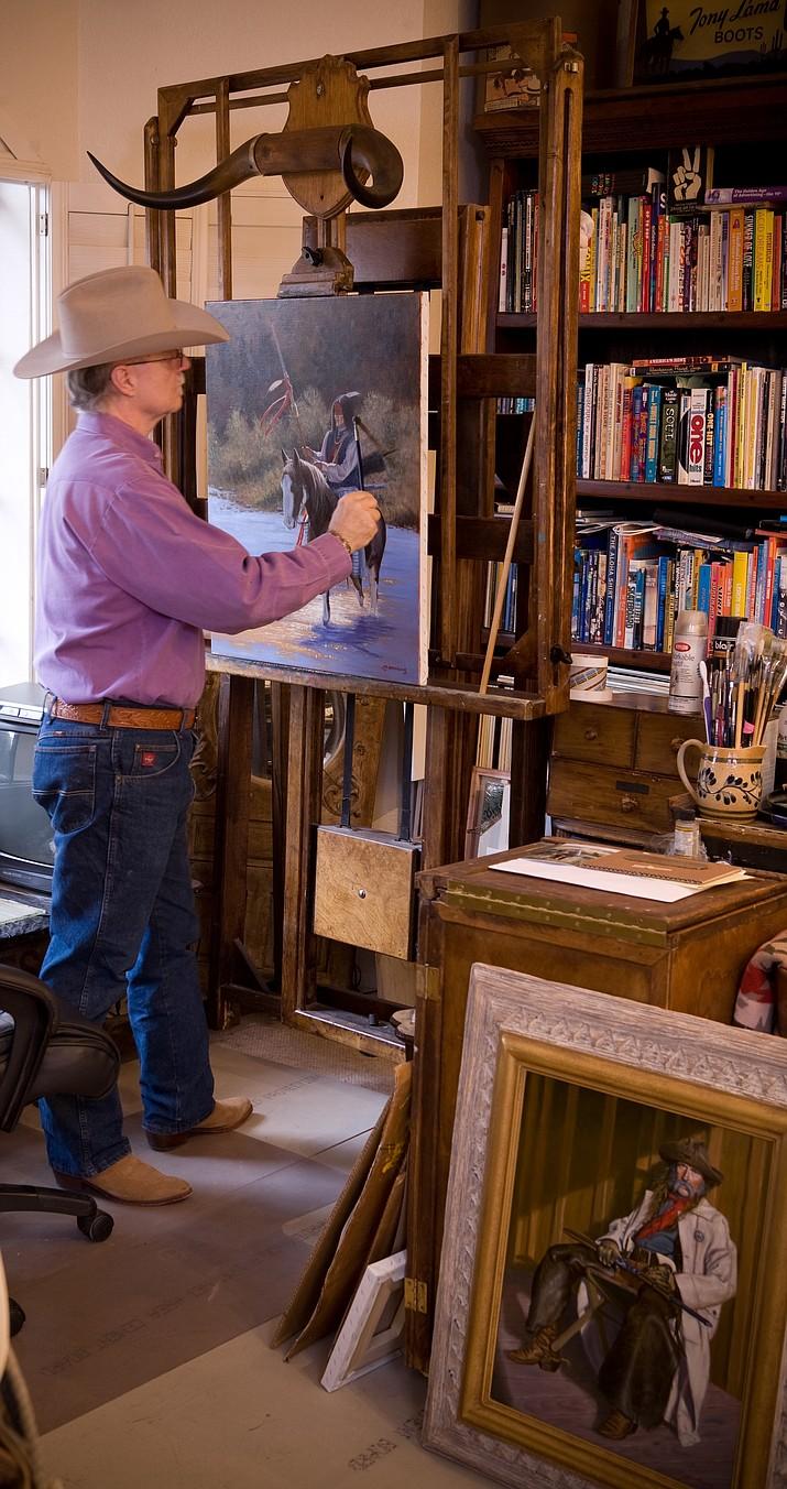 Joe Netherwood painting in his art studio. (Courtesy)