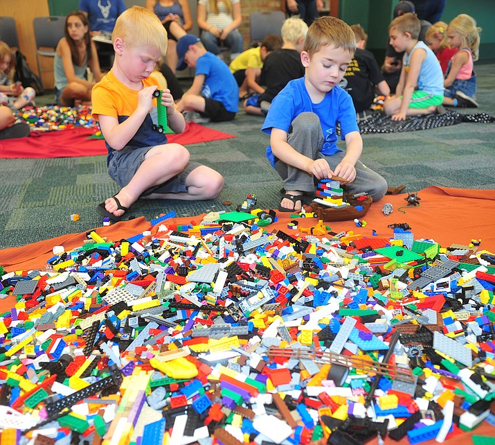 Zion Grell, 4, and Koah Mailand, 5, work on putting together their Lego creations during a Lego Drop In event on Thursday July 11, 2019, at the Prescott Public Library, 215 E. Goodwin St. (Les Stukenberg/Courier)