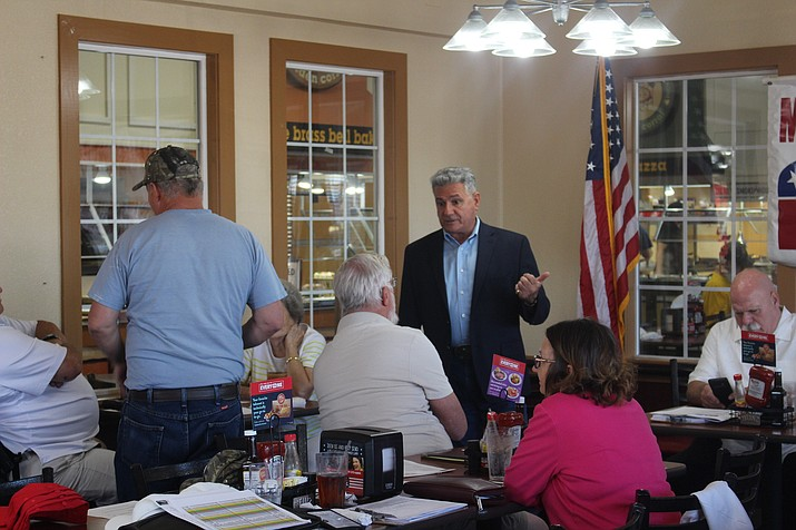 State Sen. Sonny Borrelli talking to constituents at the Mohave Republican Forum on Wednesday, July 10. MCRCC Chairman Sam Scarmardo is sitting on the far right. (Agata Popeda/Daily Miner)