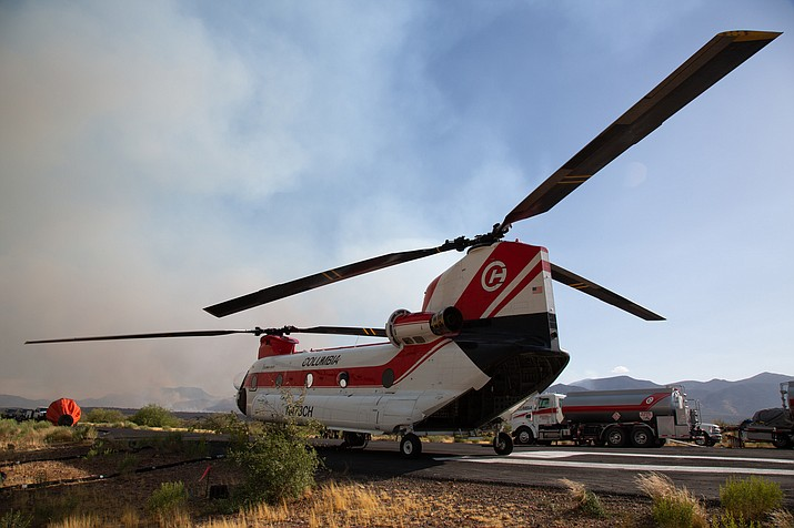 The Woodbury Fire near Superior began June 8 and now is 90% contained. Firefighters employed a CH47D helicopter, which carries a water bucket that holds up to 2,800 gallons, to battle the blaze. (Anton L. Delgado/News21, via Cronkite News)