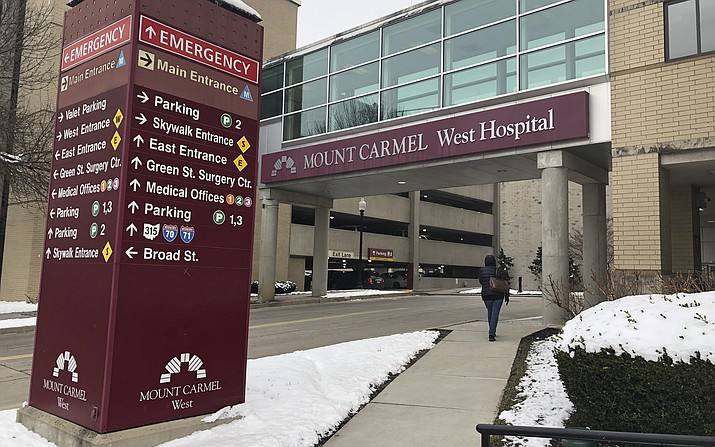 In this Jan. 15, 2019 file photo, the main entrance to Mount Carmel West Hospital is shown in Columbus, Ohio. The Mount Carmel Health System announced Thursday, July 11, 2019 that it s firing 23 more employees and changing leadership after investigating excessive painkiller doses given to dozens of patients who died. (Andrew Welsh Huggins/AP, file)
