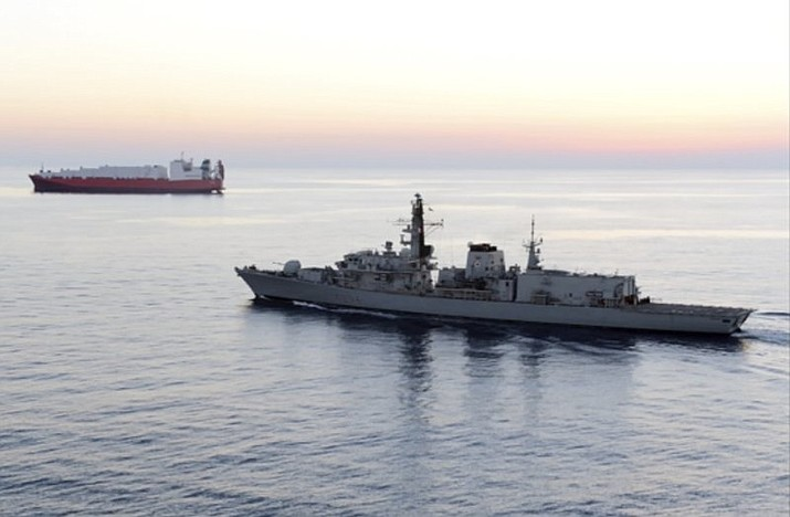 "In this image provided by UK Ministry of Defence, British navy vessel HMS Montrose escorts another ship during a mission to remove chemical weapons from Syria at sea off coast of Cyprus in February 2014. The British Navy said it intercepted an attempt on Thursday, July 11, 2019, by three Iranian paramilitary vessels to impede the passage of a British commercial vessel just days after Iran's president warned of repercussions for the seizure of its own supertanker. A U.K. government statement said Iranian vessels only turned away after receiving ""verbal warnings"" from the HMS Montrose accompanying the commercial ship through the narrow Strait of Hormuz. (UK Ministry of Defence)"