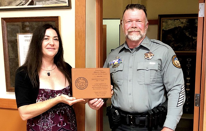 Jerome Police Chief Allen Muma, who recently completed his 20th year of service to the Town of Jerome, was presented with a commemorative plaque from Mayor Alex Barber. Town of Jerome Photo