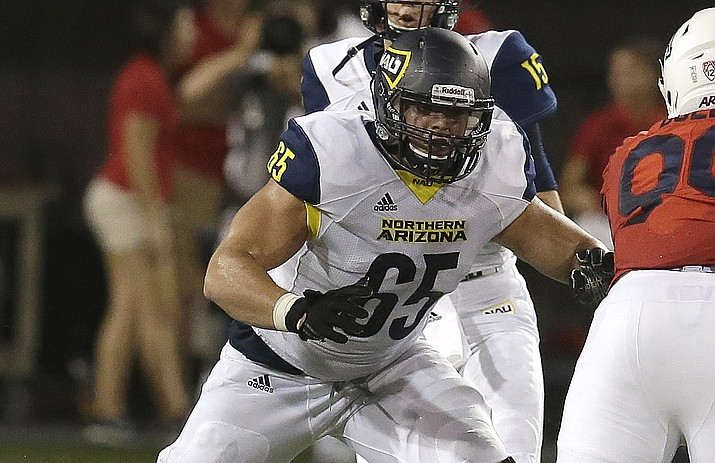 NAU offensive lineman Malik Noshi (65) in a game against Arizona, Saturday, Sept. 2, 2017, in Tucson, Ariz. A friend on Sunday discovered the 22-year-old senior offensive lineman unconscious in his Flagstaff home. Emergency responders pronounced him dead. (Rick Scuteri/AP)