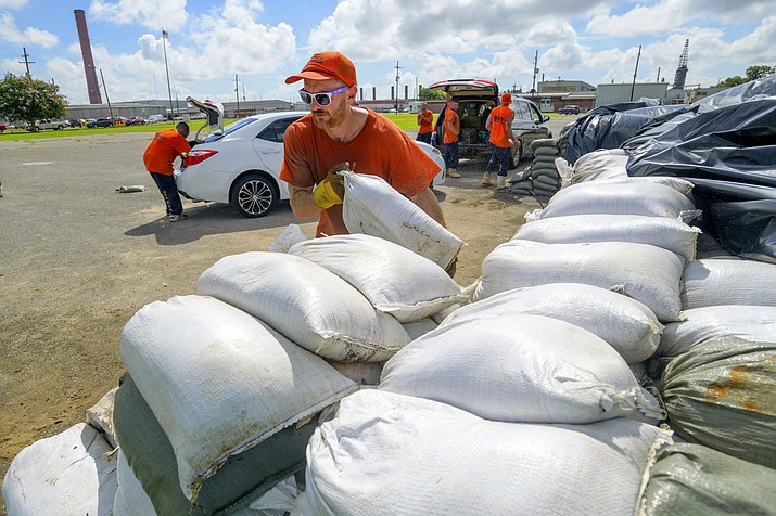 St. Bernard Parish Sheriff's Office inmate workers move free sandbags for residents in Chalmette, La., Thursday, July 11, 2019. The Mississippi Emergency Management Agency is telling people in the southern part of the state to be prepared for heavy rain from Tropical Storm Barry as it pushes northward through the Gulf of Mexico. (Matthew Hinton/AP)