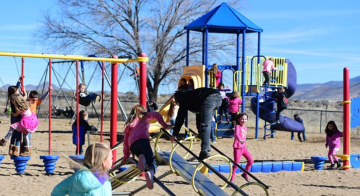 Students at Coyote Springs Elementary School in Prescott Valley hit the playground for morning recess. The City of Prescott will host a playground maintenance course from 8:30 a.m. to 4 p.m. Friday, July 12 (Les Stukenberg/Courier file)