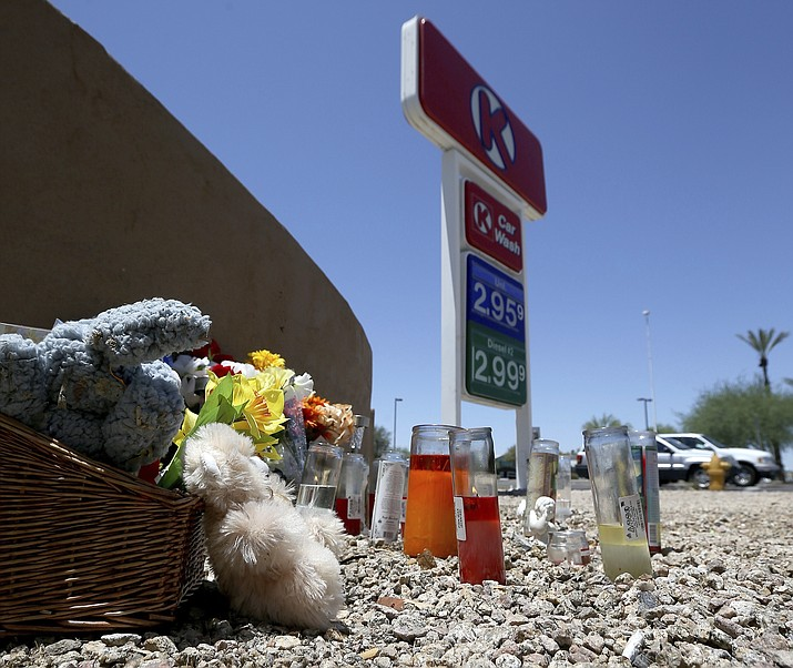 A makeshift memorial for Elijah Al-Amin is set up at a local Circle K store for the death of the stabbing victim Tuesday, July 9, 2019, in Peoria, Ariz. Peoria police arrested 27-year-old Michael Adams on suspicion of first-degree murder in the killing of 17-year-old Al-Amin, who was stabbed in his throat and back inside the store on July 4. Hundreds of people including a presidential candidate are speaking out on Twitter about the killing of a 17-year-old Muslim youth at a suburban convenience store by a white man who said he was threatened by the boy's rap music. (Ross D. Franklin/AP)