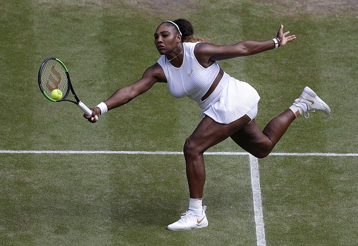 United States' Serena Williams returns to Czech Republic's Barbora Strycova during a women's singles semifinal match on day ten of the Wimbledon Tennis Championships in London, Thursday, July 11, 2019. (Alastair Grant/AP)