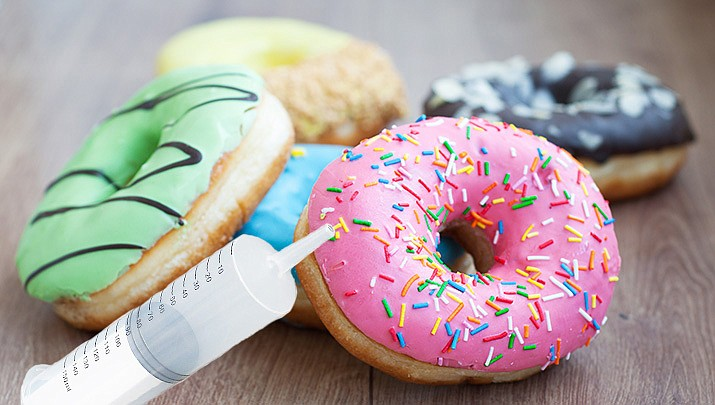 Doughnuts with a side of syringes have been nixed from the Minnesota State Fair after the offering was roundly criticized. (Monica Brabant/WNI Photo Illustration)