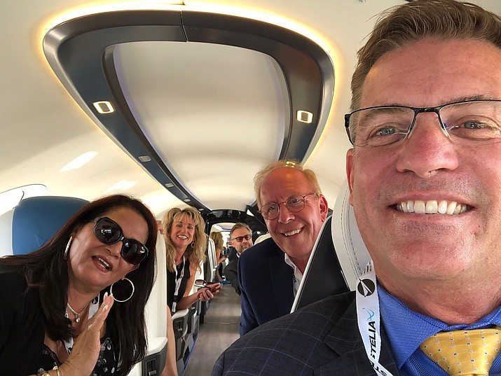 "Prescott Mayor Greg Mengarelli, right, and City Manager Michael Lamar, center back, traveled to the Paris Air Show in June for the unveiling of ""Alice"" — the all-electric plane that Israeli-based Eviation Aircraft plans to build in Prescott. Also on hand for a look at the interior of the aircraft were Rosa Moreno-Hilburn, left, Sheila Mengarelli, and Leland Moreno-Hilburn, executive director and general manager for Eviation in Prescott. (Greg Mengarelli/Courtesy)"