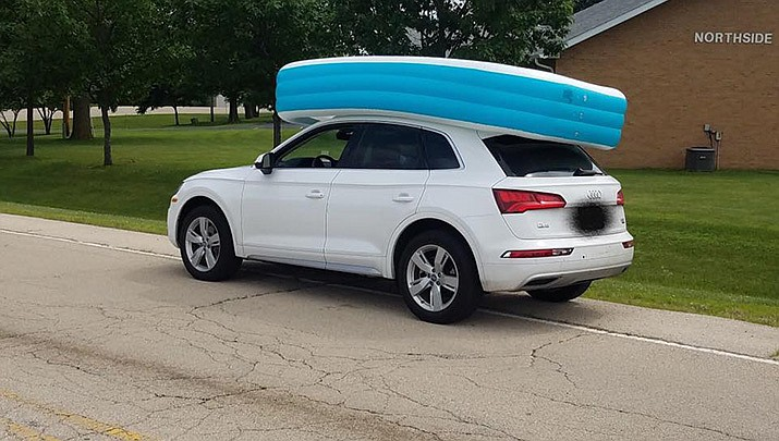 The Audi passenger car with the pool on the roof of the vehicle where two children were seen sitting inside. (Dixon, Illinois Police Department)