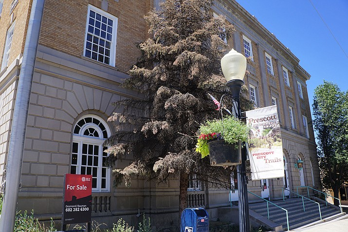 A for-sale sign went up recently outside the U.S. Post Office building in downtown Prescott.  (Cindy Barks/Courier)
